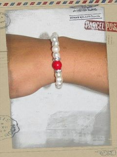 Fresh Water Pearl with a spot of Red