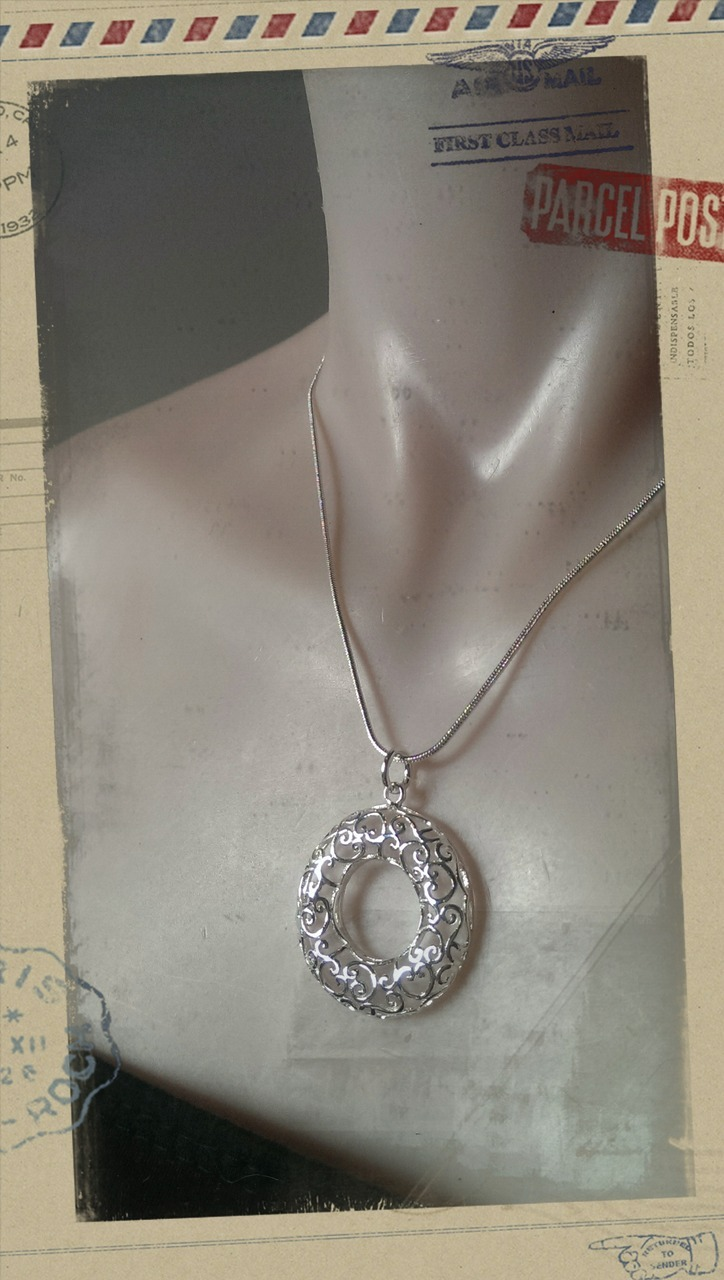 Hollow Koru Heart Pendant Necklace